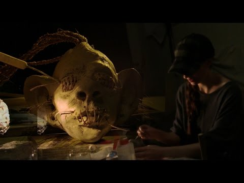 ASMR sculpting shrunken head with layered wet clay, crinkle and spray bottle sounds